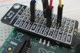2014-11-15T14:38:58.040Z-pi_gpio_reference_card_black_on_pi_with_wires.jpg
