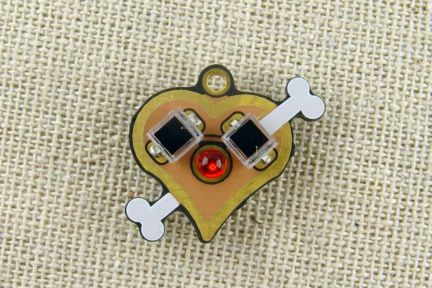 Solar powered flashing LED heart pendant, earrings