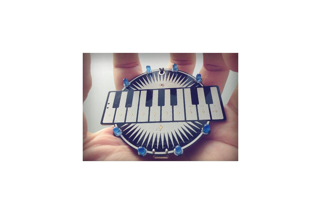 Programmable keyboard badge - lightning and music 1