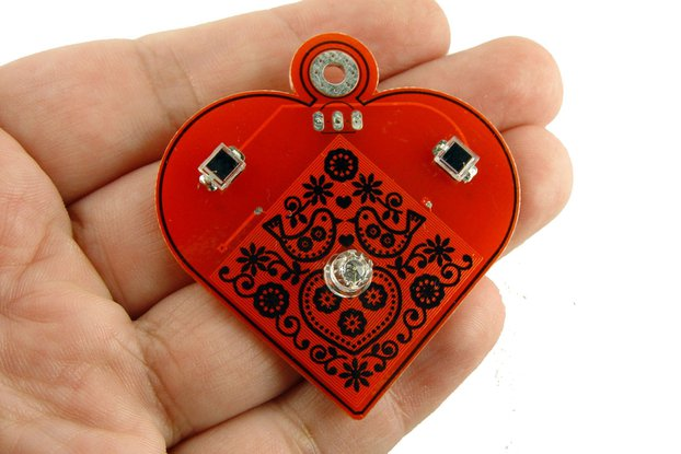 Solar powered flashing LED heart pendant