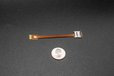 2021-04-20T12:01:30.322Z-TF Card extension cable's size compared to a quarter dollar.jpg
