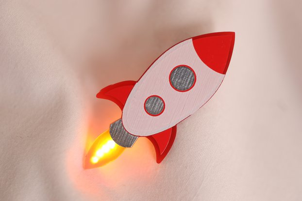 TO-THE-MOON rocket pin with animated engine