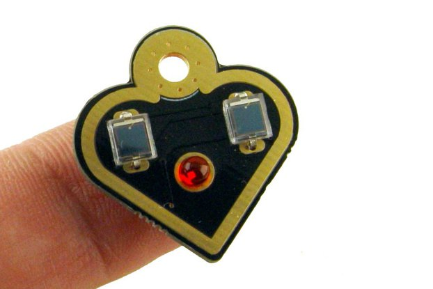 NEW Solar powered flashing LED heart earrings