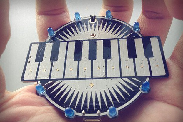 Programmable keyboard badge - lightning and music