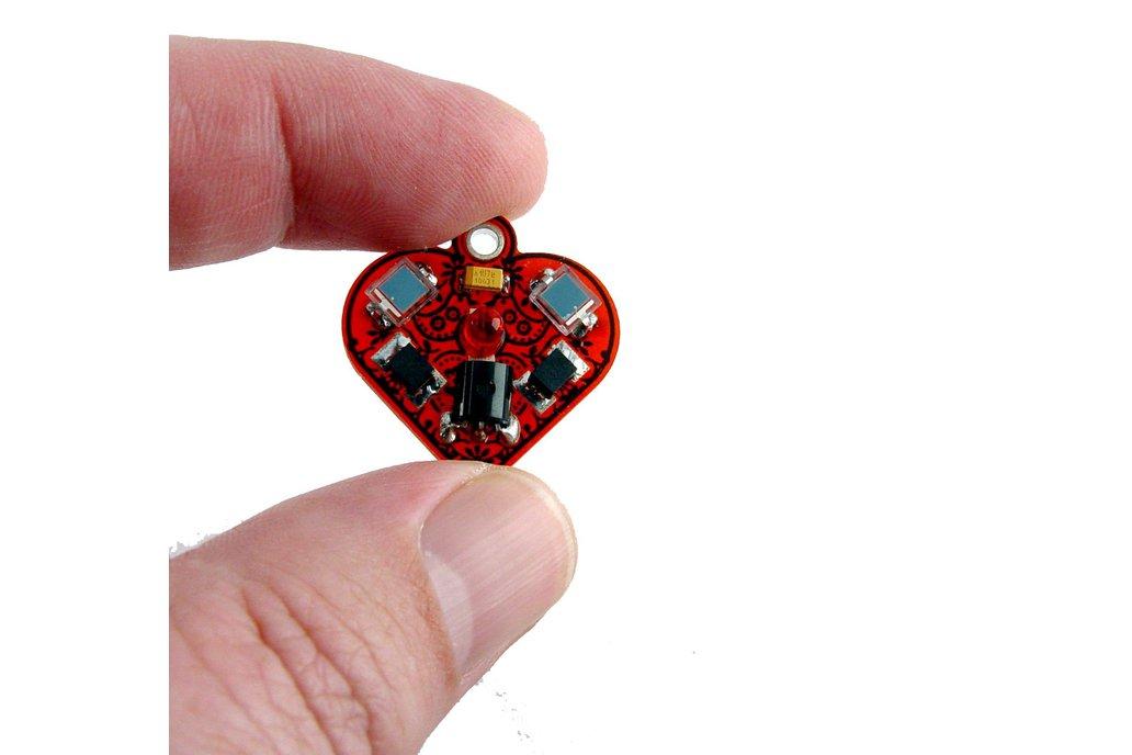 Solar powered flashing LED heart earrings 1