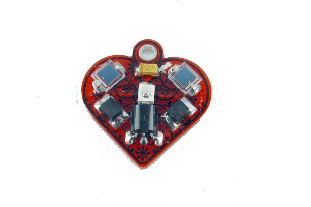Solar powered flashing LED heart earrings 2
