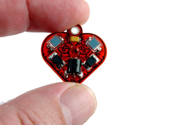 Solar powered flashing LED heart earrings