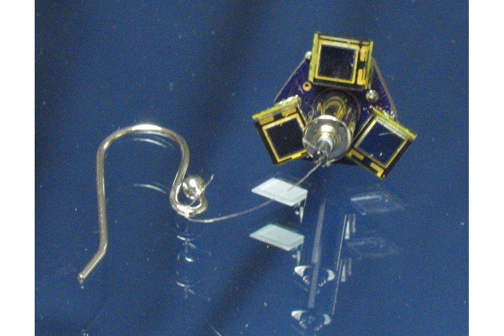 Earring, solar, motorized 1